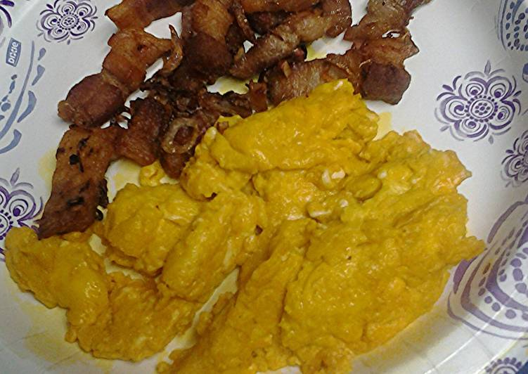 Turmeric eggs with shallots and pork belly