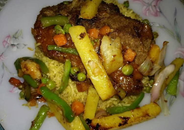 Beef Steak served with grilled veggies,sauce & Vegetables rice🔥