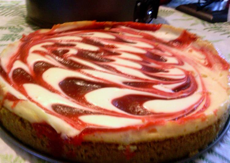 Creamy strawberry swirl cheesecake