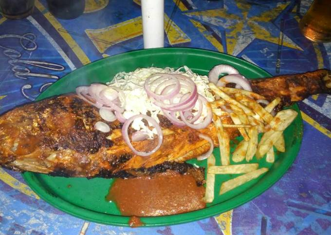 Grilled fish with irish potatoes and cucumber