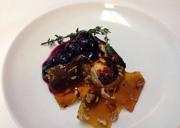 Roasted feta with Cava, thyme, blueberry compote and glass candy with toasted fennel and pecans