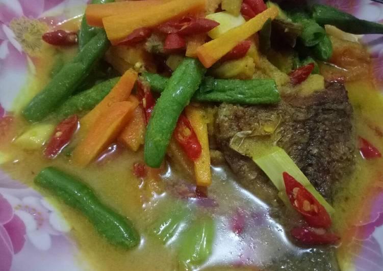 Pesmol(gulai kuning) ikan nila