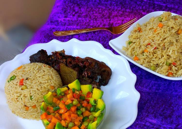Coconut rice, avocado salad and fried goat meat