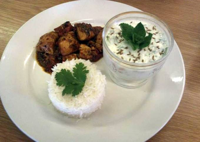 Recipe: Delicious Achar (eastern pickle) Chicken curry served with rice and a mint and cucumber raita.