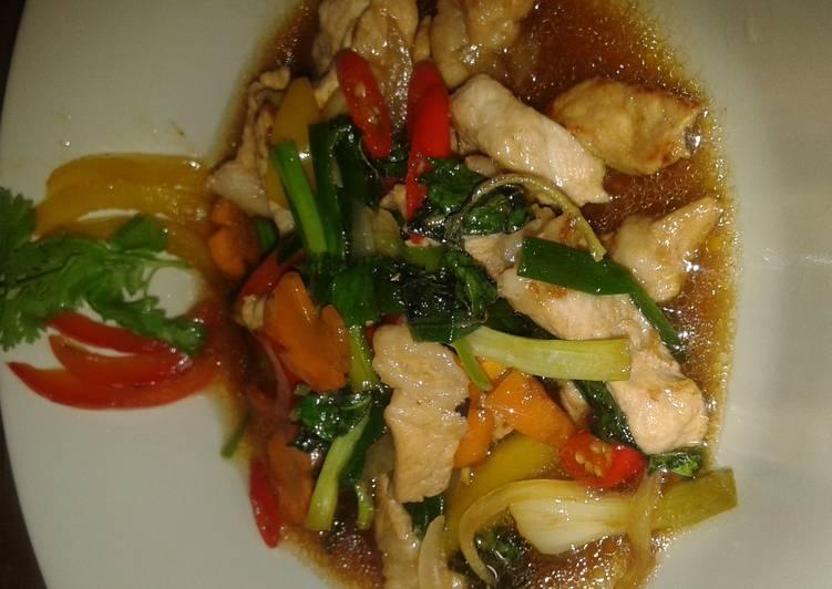 Mhu pad prik waan or pork stir fry in sweet peppers and thai chillies