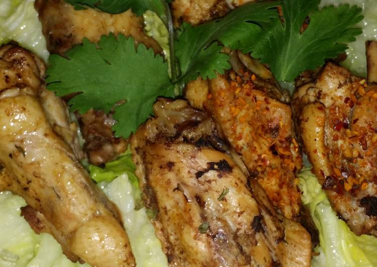 Yummy chicken wings and drums on salad