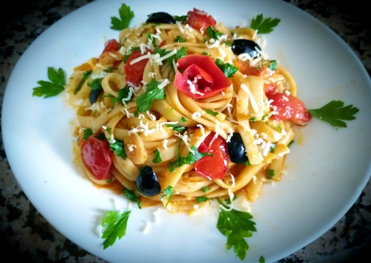 Recipe of Homemade Tagliatelle with tomato sauce and marinated cherry tomatoes