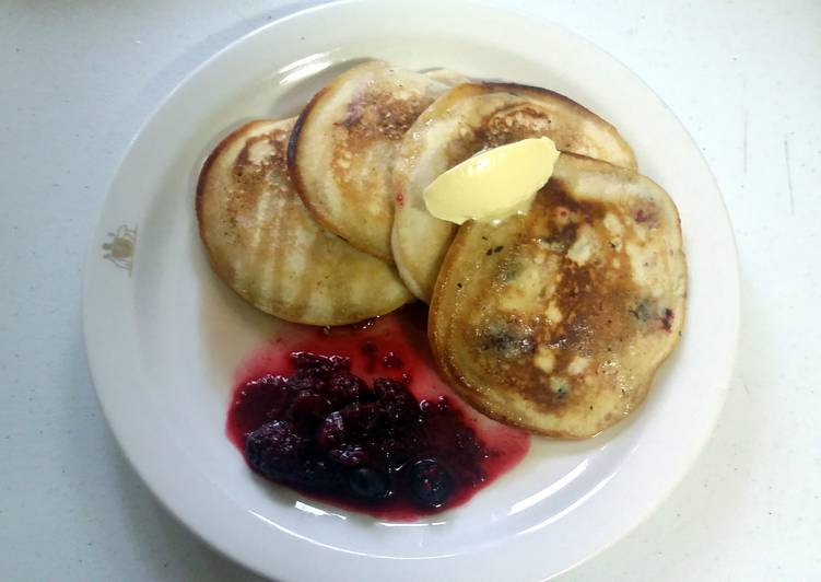 Fluffy pancakes with maple syrup butter and seasonal berries
