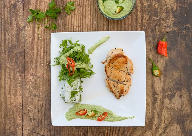 Chicken breast served with coriander rice, rocket salad and avocado coriander sauce