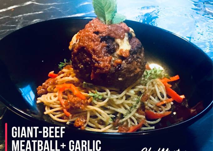 CHEESY-MEATY-HERBY  Giant Stuffed Beef Meatball with Garlic Butter Scallions and Mushrooms Spaghetti