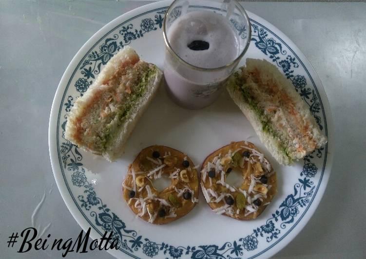Apple slice donut, cold sandwich,blueberry-pomegrante smoothie