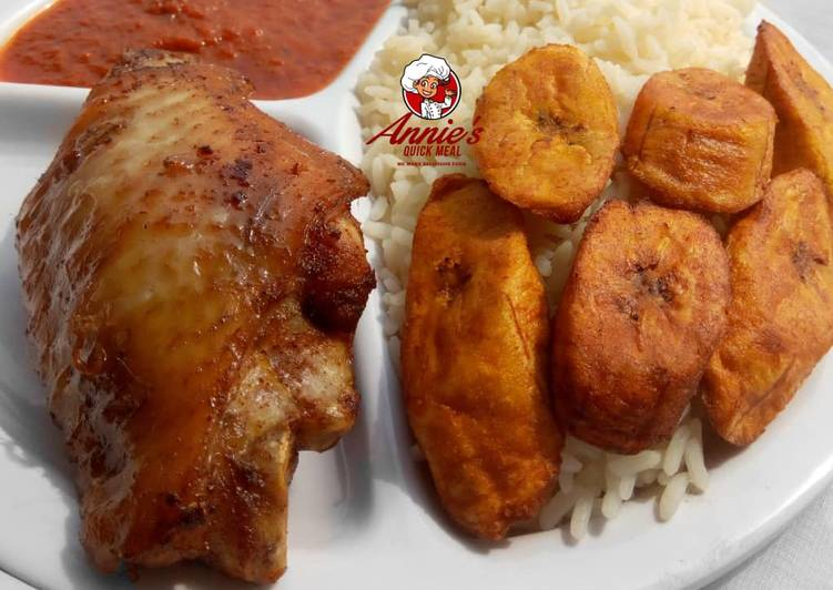 Boiled rice,fried plantain,fried turkey and tomato sauce