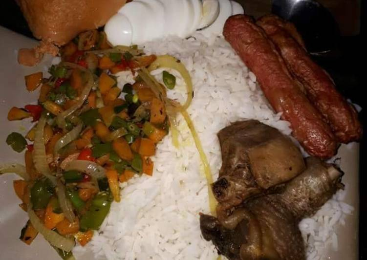 Boiled rice,fried chicken,sausages and stir fry vegetables