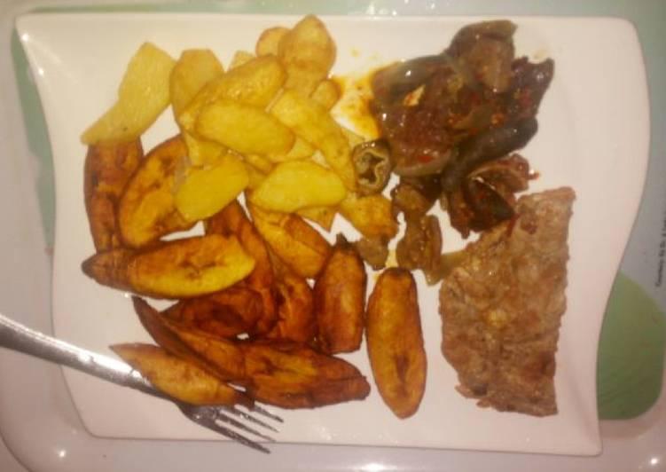 Fried Irish potatoes,plantain and egg sauce
