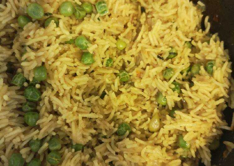 Simple Way to Make Homemade Flavoured Rice with Peas