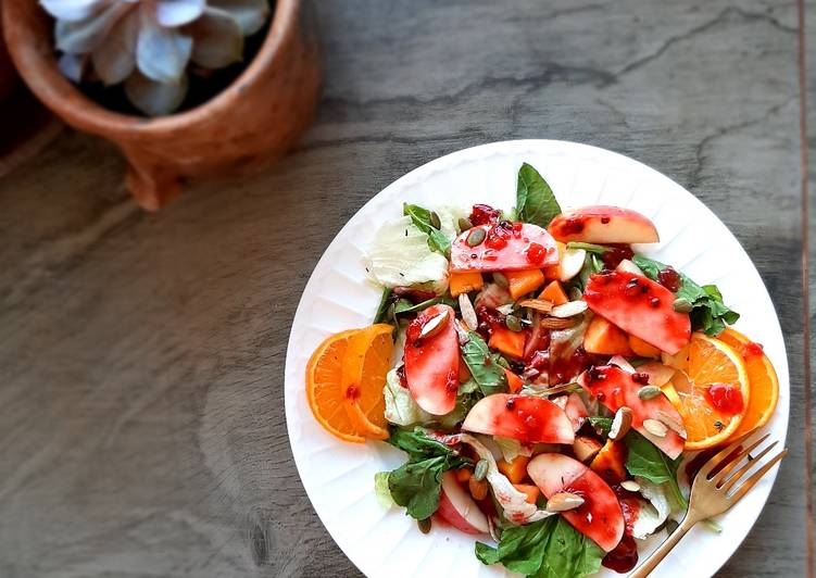 Mango peach salad with passion thyme vinaigrette