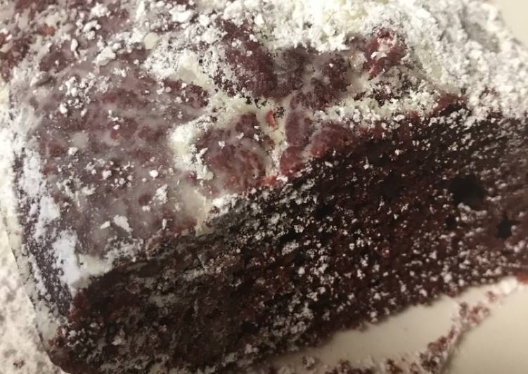 Red velvet cake with powdered sugar on top