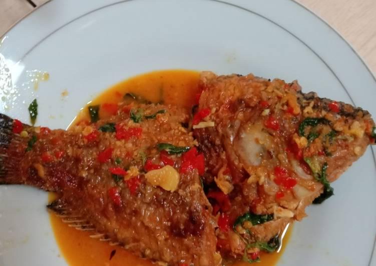 Pesmol ikan nila merah