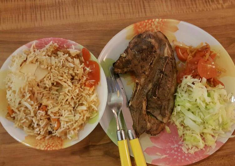 Panfried steak served with fried rice and veges