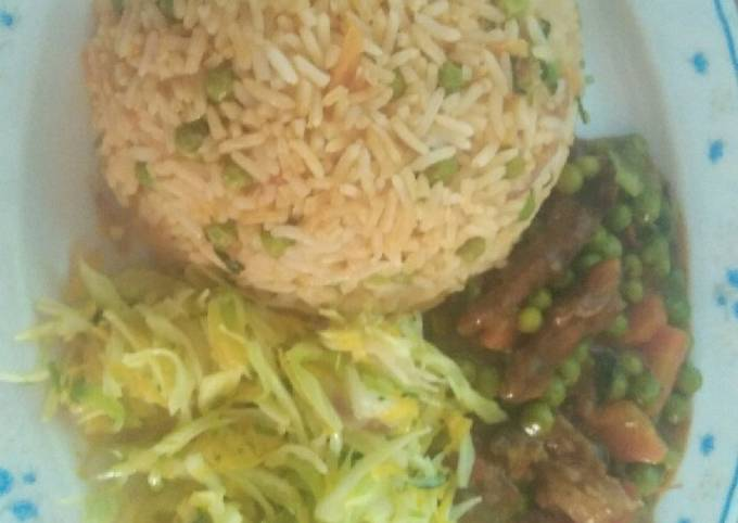 Meat gravy, steamed cabbage salad and stir fried Rice