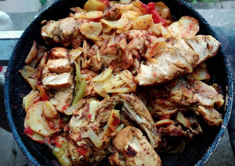 Messy chicken roast in pan
