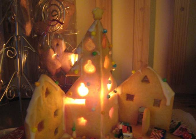 A Lit Up Decorative Cookie House For Christmas