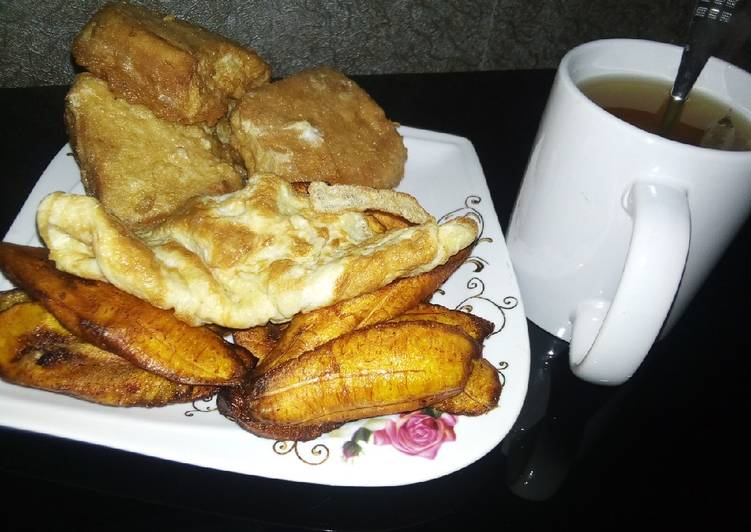 Plantain, bread in egg,egg with Tea
