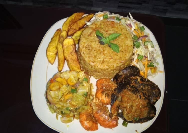 Jollof,fried plantain,fresh n fried veggie,pepered shrimp&snail