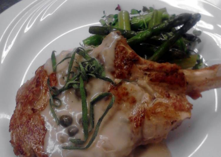 seared veal chop with creamy caper burr Blanc and wild rice pilaf