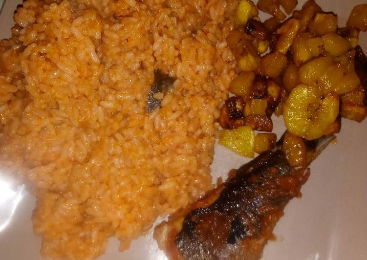 Jollof rice wit fried fish and plantain