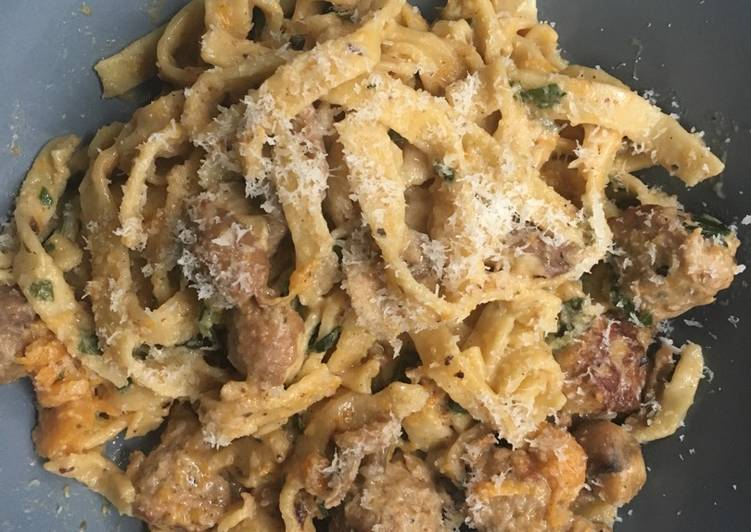 Homemade tagliatelle with pork meatballs and in a creamy sauce