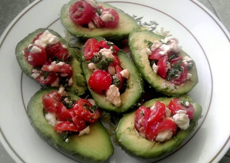 Tomato salad stuffed avocados
