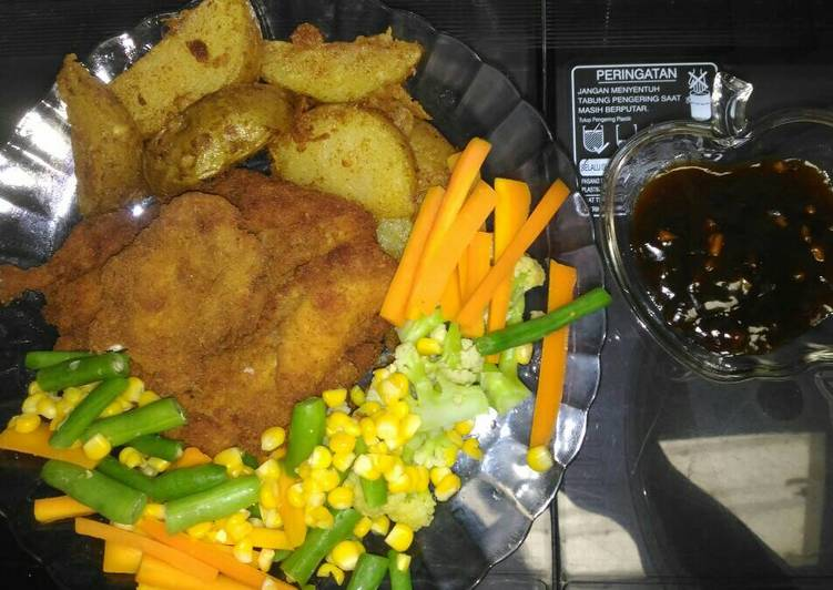 Chicken steak and potato wedges with teriyaki sauce