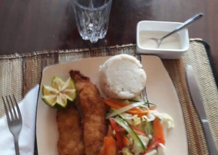 Coconut crumbed tilapia with a mixed salad and ugali
