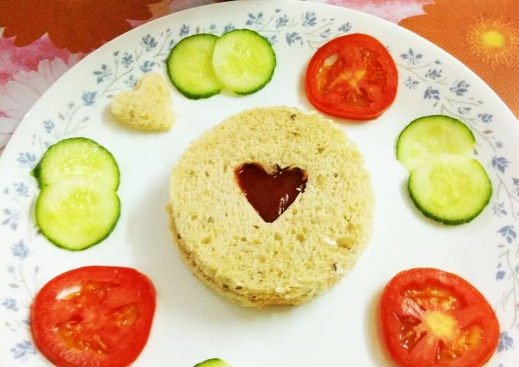 Whole grain bread with tomato ketchup and tomato,cucumber slices
