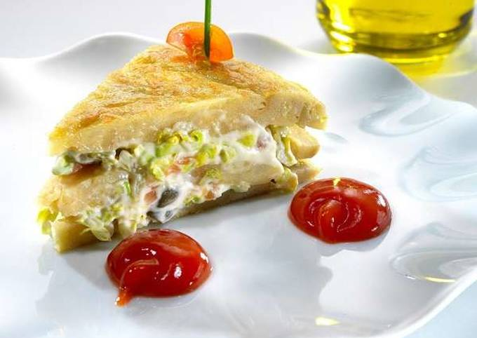 Pinchos of Spanish omelette stuffed with smoked salmon salad