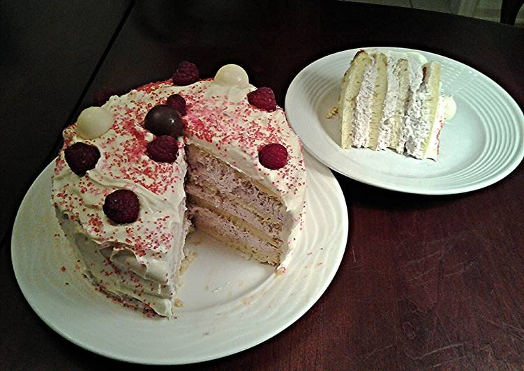 White Butter Cake layered with Raspberry Cream with a White Chocolate Frosting
