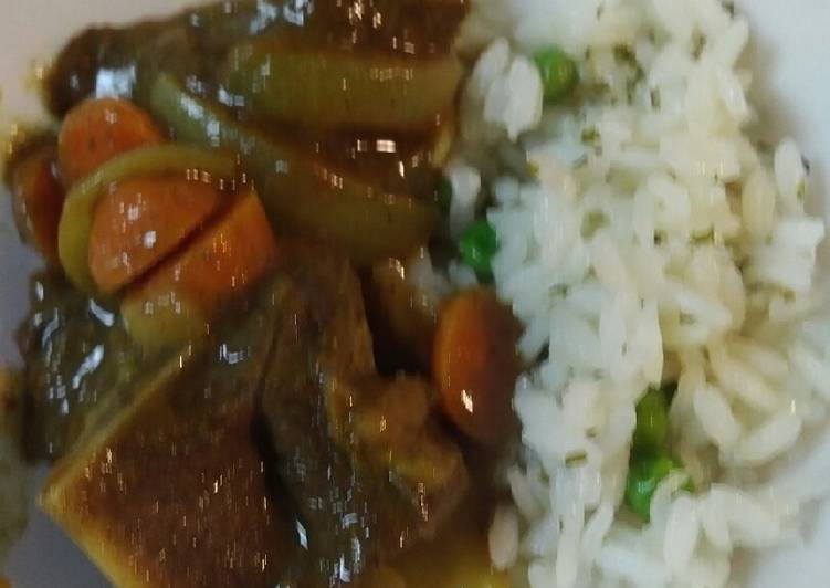Curried Goat with Parsley Pea Rice