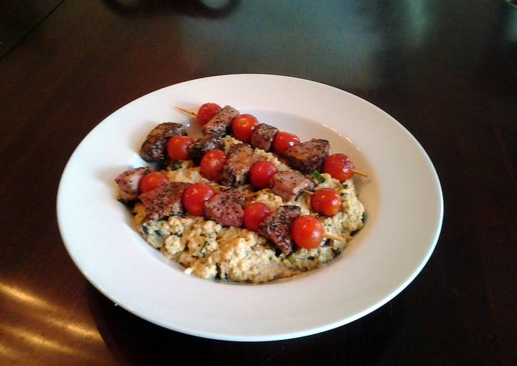 Grilled lamb and tomato kabobs with mushroom, lemon, amd parmesan couscous