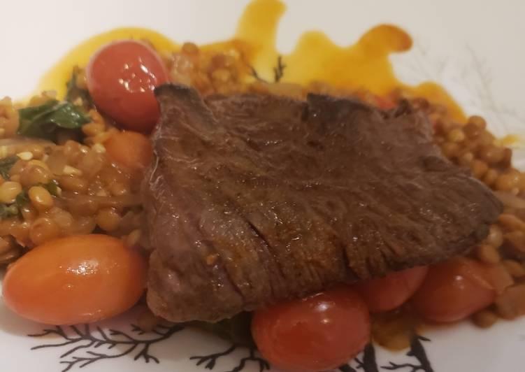 Seared skirt steak over spiced lentils
