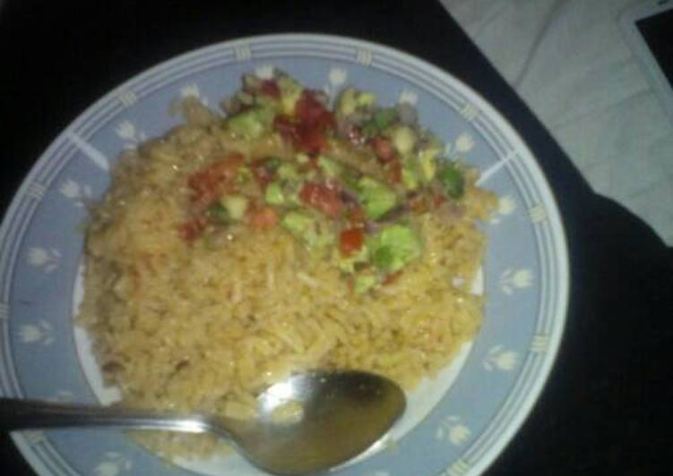 Rice with avocado and tomato salad