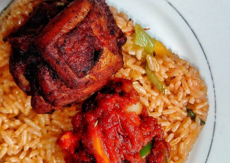 Ghanaian vegetable Jollof rice with red seasoned chicken