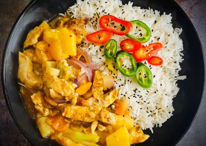 Spicy Pineapple Chicken and Basmati Rice with Mixed Chilli and Black Sesame seeds Garnish