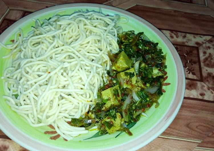 Spaghetti with green vegetable and egg moi moi