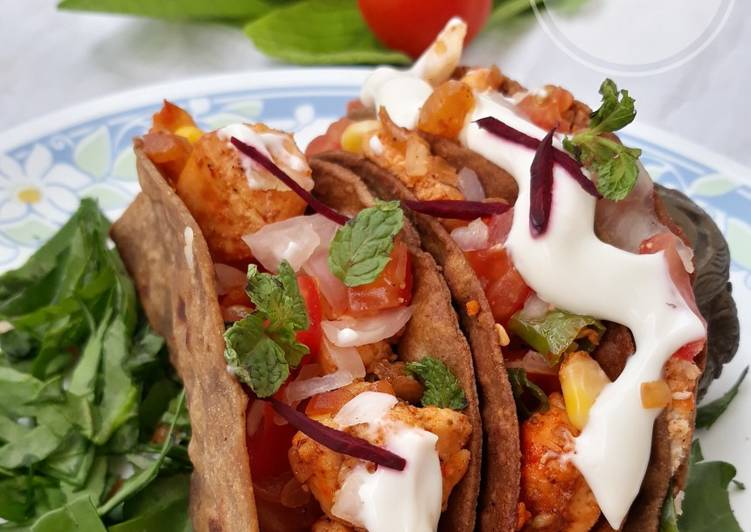 Ragi tacos with paneer and corn filling