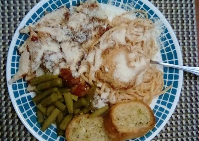 Chicken Parmesan With Spaghetti and Garlic Bread