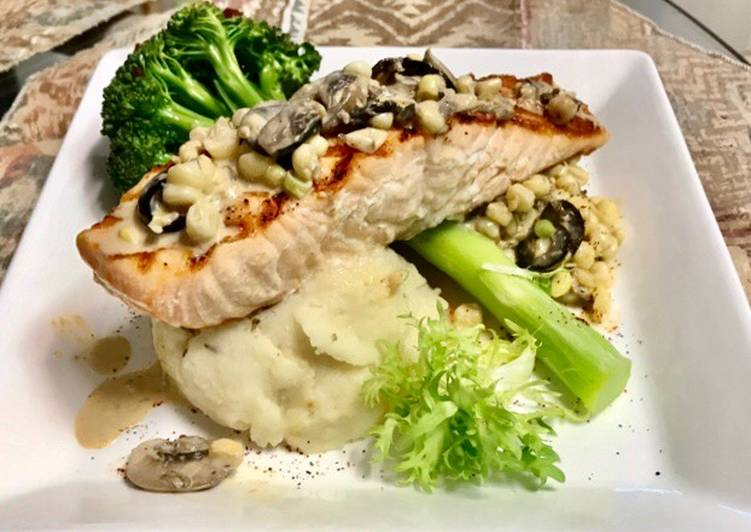 Recipe: Tasty Grilled salmon Topped with a mushroom, Black olives, White corn cream sauce Garlic Mashed potatoes