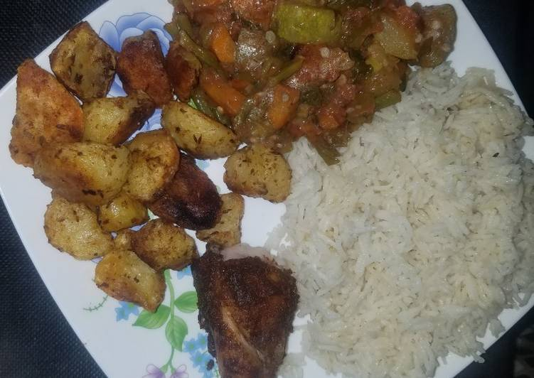 Veggie mix, roast potatoes and chicken with rice