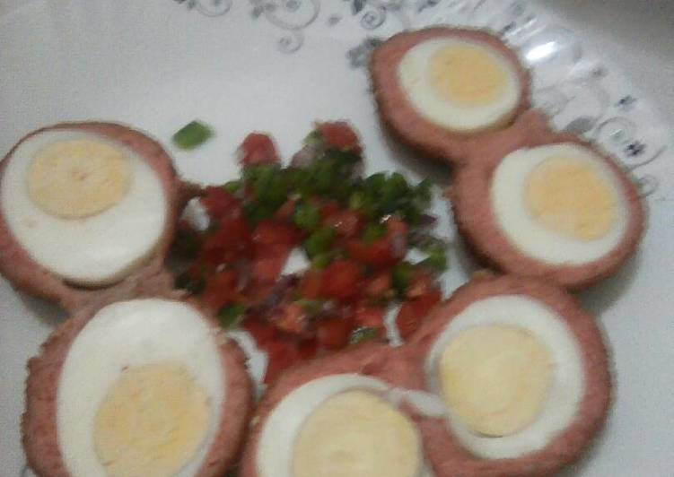 Scotch eggs served with kachumbari