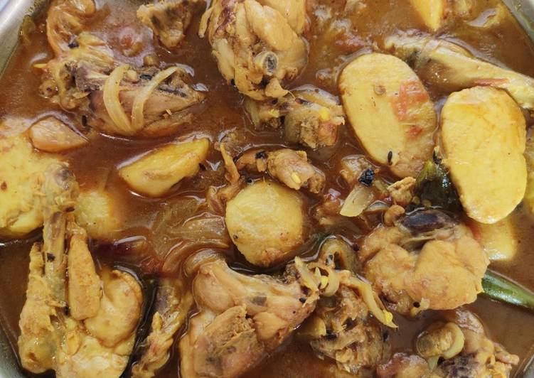 Bengali Gati kochu diye chicken curry with arbi